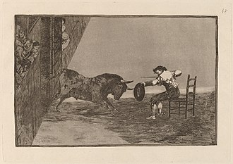 La Tauromaquia - Νο.18: The Daring of Martincho in the Ring at Saragossa, etching and aquatint 24,5 × 35,5 cm. In this work from La Tauromaquia a famous bullfighter is depicted sitting on a chair and with feet shackled together while facing the attacking bull. Here, Goya ignores  - partly - the laws of perspective, depicting the viewers in a rather unusual way in order to give to more dynamism to the work.