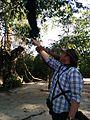 Greg and Howler Monkey - Flickr - GregTheBusker.jpg