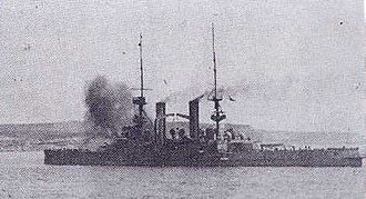 HMS Swiftsure (1903) - Swiftsure firing on Ottoman positions while covering the landings at West Beach, Cape Helles, 25 April 1915.