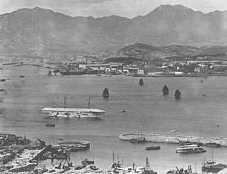 Tamar, Hong Kong - HMS Tamar (white vessel) anchored off the Naval Dockyard (1905)