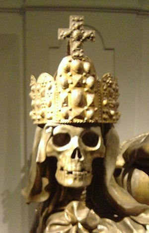 Macabre - A death head wearing the Imperial Crown of the Holy Roman Empire, on the sarcophagus of Habsburg emperor Charles VI in the crypt of the Capuchin church in Vienna, Austria.
