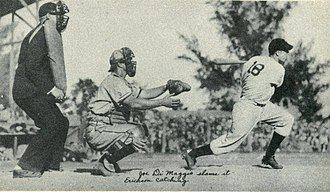 Hank Erickson - Erickson behind the plate while Joe DiMaggio hits the ball.