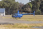 Heliflite (VH-XVZ) Robinson R44 Raven II at Sydney Airport.jpg