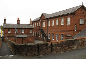 British Schools Museum - The 1857 school building with the houses for the Master and Mistress to the left.