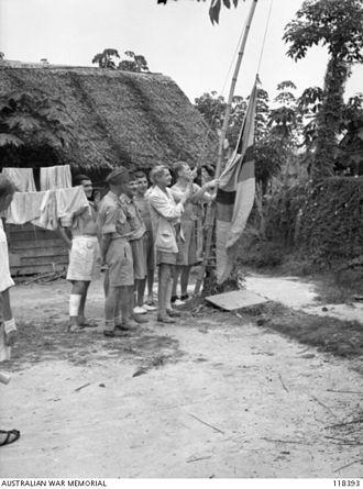 Sarawak Day - Image: Hoisting the Sarawak flag, 1945 (AWM 118393)