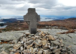 "Holta - A cross marking the crash site near Holta. The plaque reads ""In memory of those who died here 9 August 1961. 34 English school boys, their two teachers and the three crew members. Erected by friends in Rogaland""."
