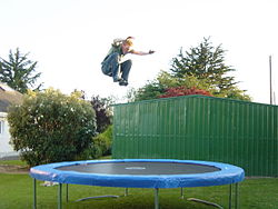 A person jumping on a trampoline