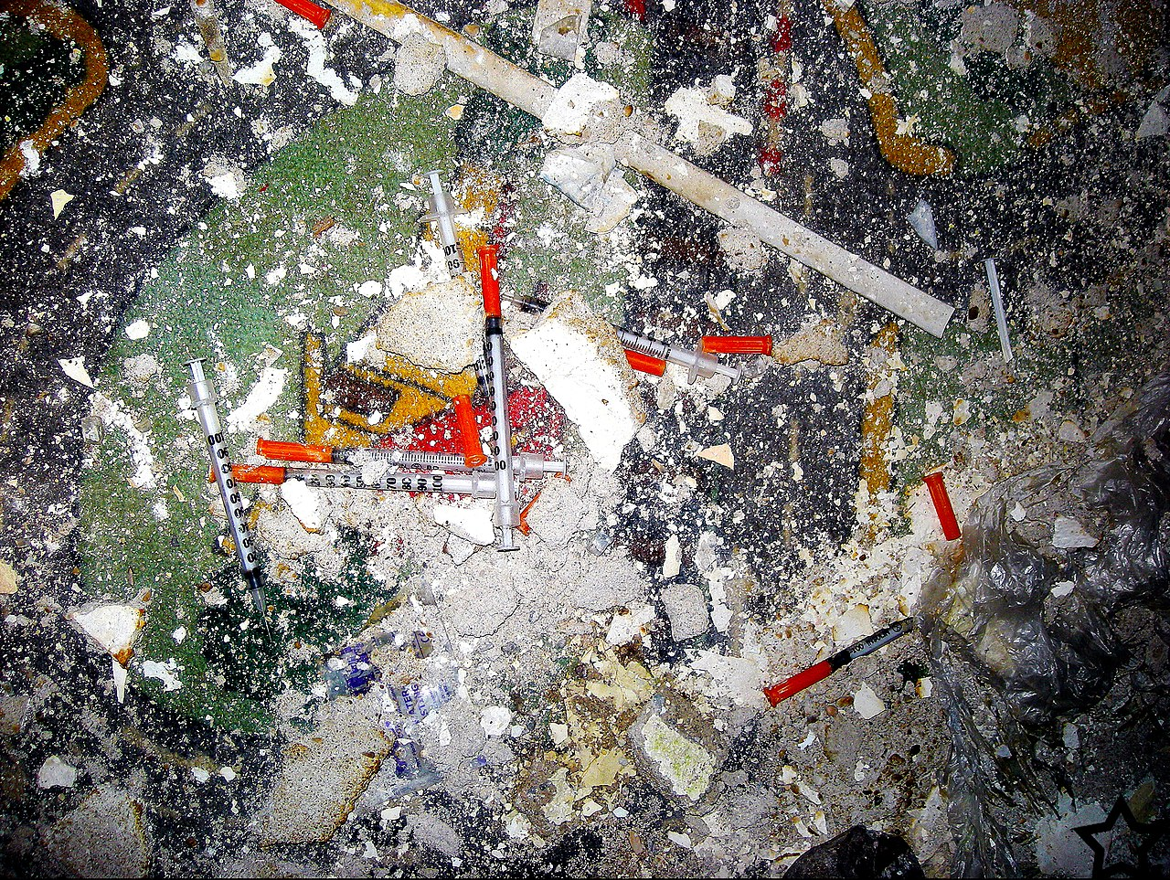 discarded syringes and garbage