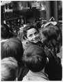 Iglesias, Italy. Along the Via Matteoti, main street of Iglesias, children stand entranced before a window display of... - NARA - 541738.tif