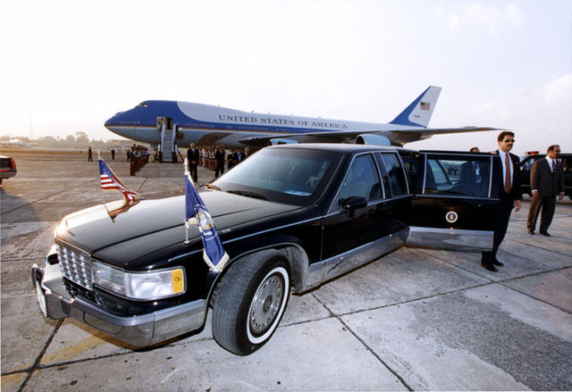 From commons.wikimedia.org: Image of Air Force One, Secret Service Agents and the Presidential Limousine {MID-71661}
