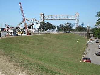 Industrial Canal - View from near the Mississippi River end of canal, with structures of St. Claude, Claiborne, and Florida Avenue bridges visible.