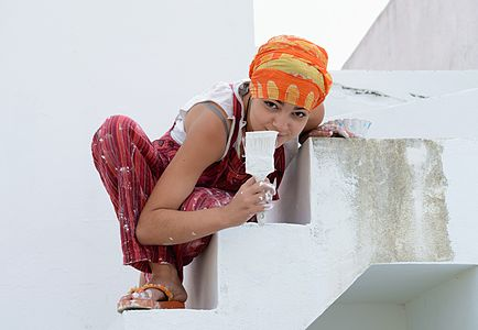 Girl painting a white staircase