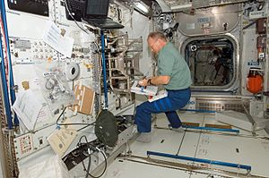 Columbus (ISS module) - Hans Schlegel working on outfitting Columbus