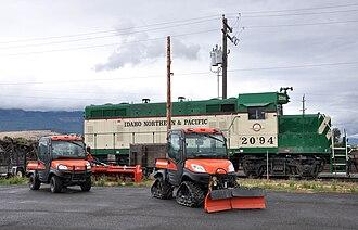Island City, Oregon - Locomotive and other vehicles near Island Avenue