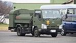 JASDF 2000L fuel tank truck(Isuzu ELF, 49-7606) right front view at Tsuiki Air Base November 26, 2017 01.jpg