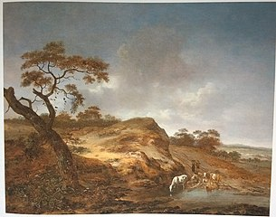 Dune landscape with cattle and cowherds near a pond