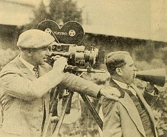John Arnold (cinematographer) - Arnold (left), with director Edward Cline on the set of the 1924 film, Along Came Ruth
