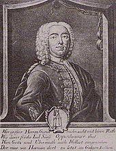 Satira bildigo de Joseph Süß Oppenheimer kun la ferpendumiloj de Stutgarto kiel emblemo sur la fundo. Kuprogravuro (1738)