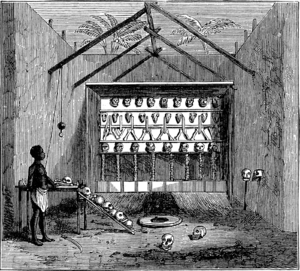 "Juju - An 1873 Victorian illustration of a ""Ju-ju house"" on the Bight of Benin showing fetishised skulls and bone"