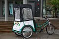 Juneau pedicab equipped for a rainy day 563 01.jpg