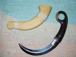Kerambit knife and sheath.JPG