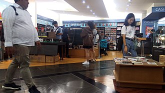 Shopping - Shoppers looking around for books and toys