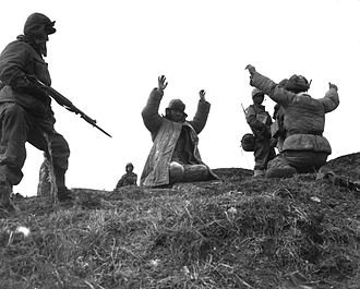 IX Corps (United States) - 1st Marine Division soldiers capture Chinese prisoners of war.