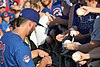 Kris Bryant signing autographs during his rehab assignment against Omaha (44267169942).jpg