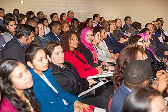 Immigration to the United States - Naturalization ceremony at Oakton High School in Fairfax County, Virginia, December 2015.