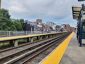 "Flushing–Main Street station (LIRR) - View from eastbound Platform ""B"" to Port Washington"