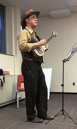 Lil' Rev - Lil' Rev, with his Mya-Moe resonator ukulele teaching a class.