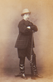 Luís, King of Portugal, arms folded on the gun barrel of a shotgun (1864).png