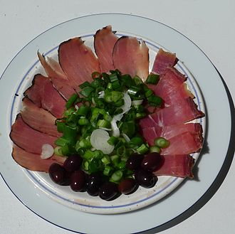 Cured pork tenderloin - Sliced lountza (left) along with chiromer, onions and olives