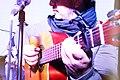 Músico en Concierto con Guitarra Requinto.jpg
