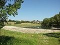 Mšecké Žehrovice, vypuštěný rybník a obec.JPG