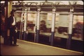 MAN BACKS AWAY FROM ROAR OF SUBWAY TRAIN - NARA - 548259.tif