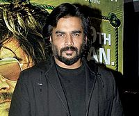 Madhavan posing for the camera at the premiere of his 2016 film Saala Khadoos