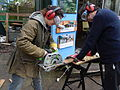 Maintenance work (circular saw) at Gunnersbury Triangle.JPG
