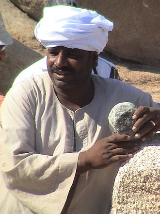 Obelisk making technology in ancient Egypt - Modern Egyptian suggesting the use of Diorite balls as carving tools for granite, at Aswan; a frequently repeated but scientifically unproven method