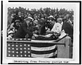 Manager Stanley Harris, in the grandstand, presents President Coolidge with the baseball used to open the 1924 World Series LCCN94508008.jpg