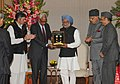 Manmohan Singh releasing the commemorative coins for Silver Jubilee of Mata Vasishno Devi Shrine Board, in New Delhi. The Governor of Jammu and Kashmir, Shri N.N. Vohra, the Union Minister for New and Renewable Energy.jpg