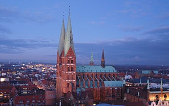 Brick Gothic - St. Mary's Church in Lübeck, Germany with red and varnished brick, edges of granite and cornices of limestone