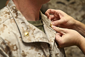 Major - A United States Marine Corps officer being promoted from captain to major