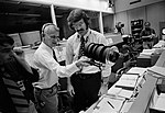 McCandless shows occulting disc to flight director Hutchinson.jpg