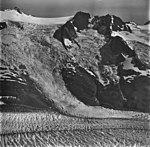McCarty Glacier, tributary feeding into tidewater glacier, hanging glaciers with icefall, September 4, 1977 (GLACIERS 6631).jpg