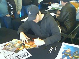 English: Ed McGuinness signing at Free Comic B...
