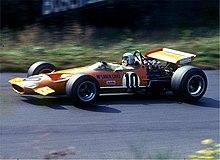 Bruce McLaren pilotant une de ses monoplaces au Grand Prix d'Allemagne 1969.