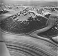 Meade Glacier, valley glaciers merging creating lateral moraines, August 27, 1969 (GLACIERS 5246).jpg