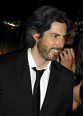A profile image of Jason Reitman. A young, caucasian male with shoulder-length dark hair. He is seen from his right, smiling towards something off camera.