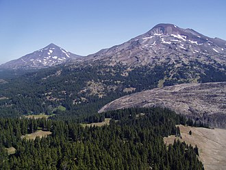 Three Sisters (Oregon) - Aerial view over the Three Sisters Wilderness, showing Middle Sister (left) and South Sister